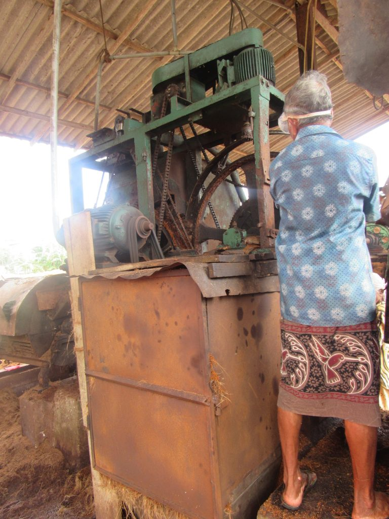 Coir Mill worker with machinery