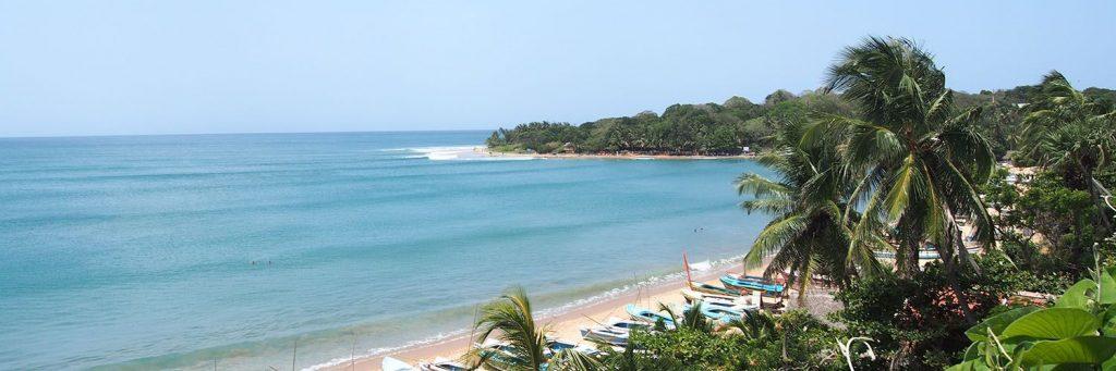 The white sand beach of Arugam Bay on the East coast in Sri Lanka.